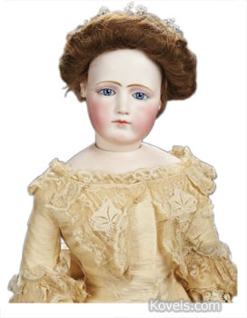 French bisque doll in antique gown