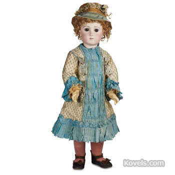 "French bisque ""Bébé Triste"" toddler doll,"