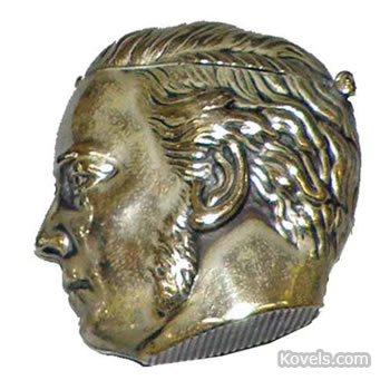 Man with sideburns figural match holder