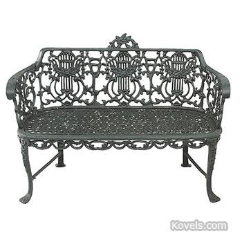 Painted cast-iron garden settee