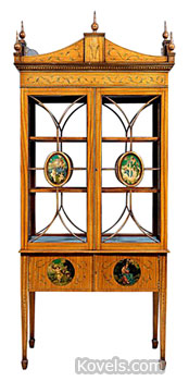 This cabinet in the Adam style was made to display porcelains or other decorative items. The 94-by-42-by-28-inch wooden and glass piece is covered with figured satinwood veneers. It sold for $3,910 at Brunk Auctions in Asheville, N.C.