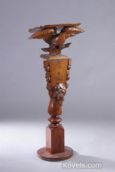 This Civil War-era speaker's podium, 44 inches high, is decorated with a carved American eagle. It sold for $885 at a Sloans & Kenyon auction in Chevy Chase, Md., a few months ago.
