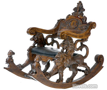 """This large 1892 chair made for the Columbian Exposition in Chicago is labeled """"Anti. Brothers, Vincenza, Italy."""" It has prominent rockers and is decorated with lions, female figures and even an American Indian's head. Garth's Auctions in Delaware, Ohio, sold the chair for $7,344."""