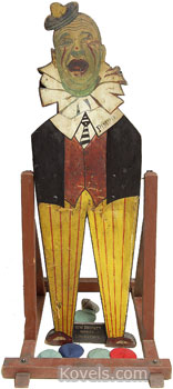 """This swinging figure, 64 by 19 inches, is from the """"Pimpo The Clown Bean Bag Toss"""" carnival game. It's colorful and amusing and shows the originality of the game creator. Cyr Auctions of Gray, Maine, offered it at auction in January with a presale estimate of $2,000 to $3,000."""