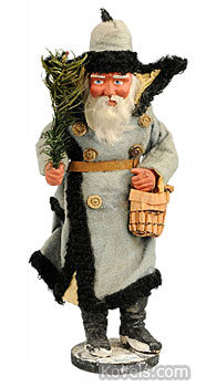 This 10-inch-tall Santa Claus wears a blue cloth coat and carries the traditional fir tree and a basket of goodies. The blue coat suggests he dates from before 1915. The figure was made in Germany, probably to be used as a candy container. Morphy Auctions sold Santa for $4,025 in 2010.