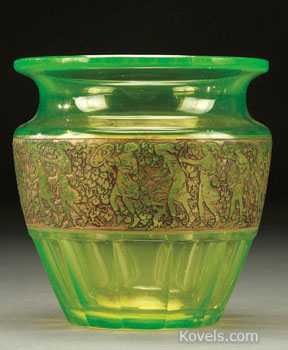 A gold-colored band decorates this Vaseline glass vase made by the Moser Glass company in the 1920s or '30s. The 4 1/2-inch-high vase sold for $200 at a Jackson's auction in Cedar Falls, Iowa.