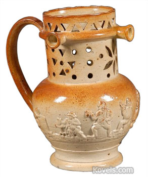 Try drinking from this pierced puzzle jug without getting wet (use the handle as a straw). This 19th-century stoneware jug sold for $356 at a Skinner auction in Boston.