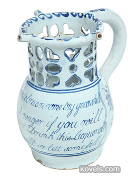 Find a way to get your drink from this jug with cutouts. It is an 18th-century English Delft mug about 7 inches tall that's decorated with piercings and an appropriate rhyme. It sold for $2,938 last year at Garth's Auctions in Delaware, Ohio.