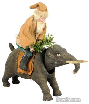 Santa on elephant nodder