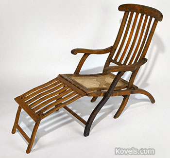 This genuine Titanic folding deck chair was salvaged by one of the ships recovering bodies at the site of the sinking. The teak chair is 4 1/2 feet long.
