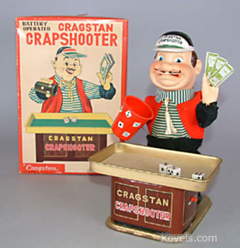This is the Cragstan Crapshooter, a battery-operated man who chews while he waves his money, shakes his cup, then throws the dice. The 9 1/2-inch toy was made by Yonezawa, a Japanese firm, and sold last fall for $88 at a Smith House Toy & Auction Co. auction in New Jersey.