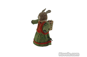 "This 6-inch-tall rabbit can ""walk"" across the floor. The fur-covered clockwork toy has glass eyes, wears a felt dress and carries a wicker basket. It was made in Germany probably about 1900 and sold for $633 at a Bertoia auction in Vineland, N.J."