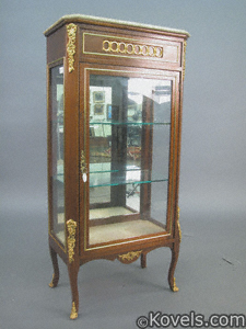 Mahogany cabinet with marble top