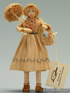 Girl with basket cornhusk doll