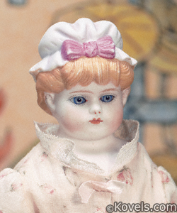German Bisque sculpted cap doll