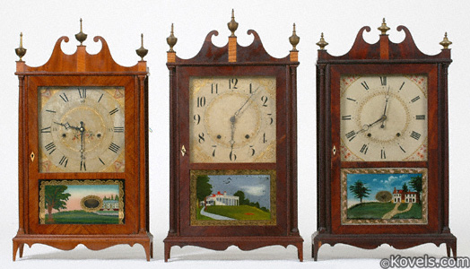 Three pillar and scroll mantel clocks