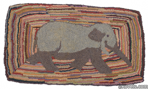 Multicolored hooked rug, elephant in center