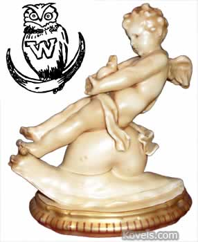 cupid-figurine-with-owl-wittman-roth-mark