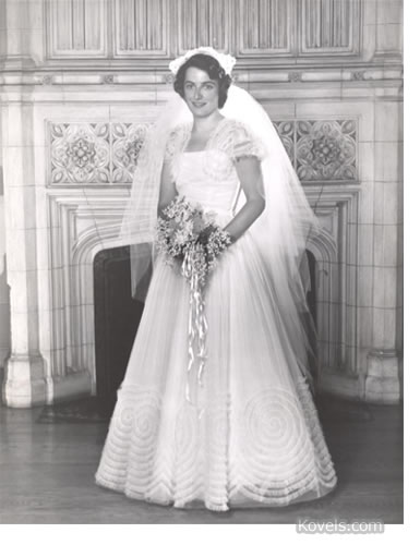 Terry Kovel wearing wedding gown, 1950