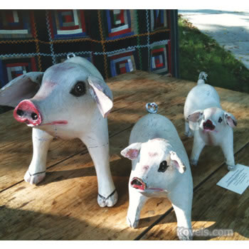 Family of wooden pigs