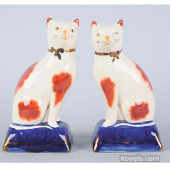 Pair of Staffordshire cat figurines