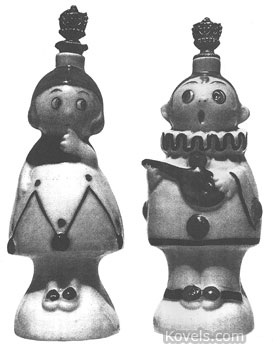 These crown-top perfume bottles are Pierrot and Pierrette. They were made by the W. Goebel factory of Germany. This pair, shown at the International Perfume Bottle Association Convention, were purchased separately by Pauline Fitzsimmons, a long-time collector.