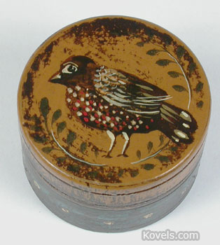 Peter Ompir, a 20th-century folk art painter, decorated this small wooden box. It is worth $160. (Photo credit: Showcase Antique Center, Sturbridge, Mass.)