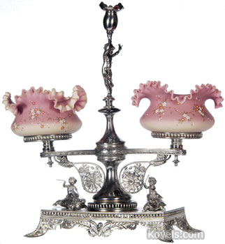 This double bride's basket has two ruffled Burmese bowls decorated with enameled flowers. The silver-plated holder is signed