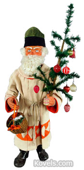 This clockwork nodder Father Christmas is holding a feather tree, an early type of Pennsylvania Christmas tree. The 37-inch-high figure sold for $4,025 at a Morphy auction in Denver, Pa., in September.