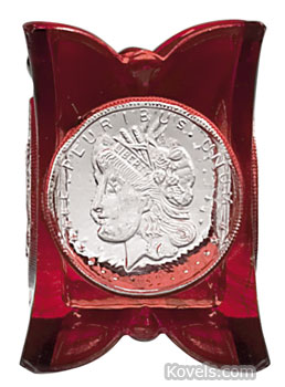An original, slightly damaged U.S. Coin glass ruby-stained toothpick holder showing a silver dollar sold last fall at Green Valley Auctions in Mt. Crawford, Va., for $660.