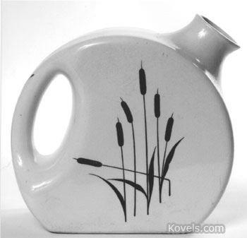 This cattail refrigerator jug was made 50 years ago but is back in style. It is worth $35.