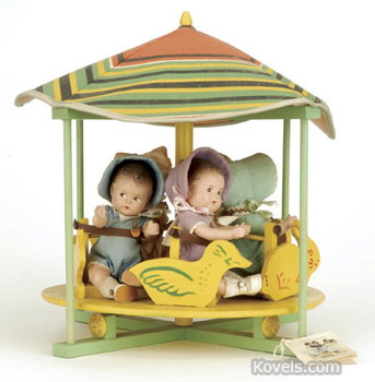 The five girl dolls in the merry-go-round are the Dionne quintuplets at age 2. The complete toy sold last fall for $4,125 at a Noel Barrett auction in Carversville, Pa.