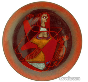 An enameled abstract design of a woman on a red background is on this tray-shaped piece of copper. It's signed
