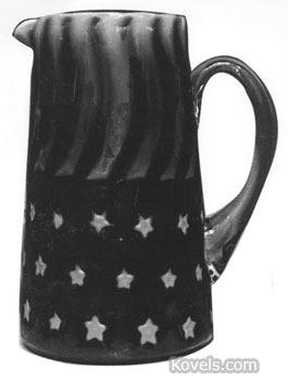 This 8 1/4-inch cranberry Stars and Stripes tankard sold for $4,700 at a Green Valley Auction in February. It is an unusual pattern for opalescent glass.
