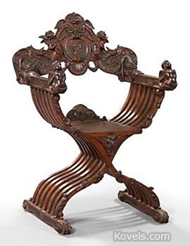 This is a carved walnut Savonarola chair made in Italy about 1875. It sold at New Orleans Auction Galleries for $1,100.