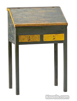 This 19th-century schoolmaster's desk was probably made in Canada. The pine desk, 39 inches high, has two tiers of cubbyholes inside. Cowan's Auctions of Cincinnati sold it for $720.