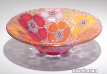 This slumped bowl with a flower design is engraved