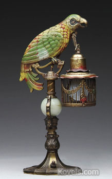 This unusual bronze parrot-shaped table lamp holds a lantern with an electric light bulb inside. The 15 1/4-inch lamp attracted a buyer who spent $518 for it at a James Julia auction in Fairfield, Me.
