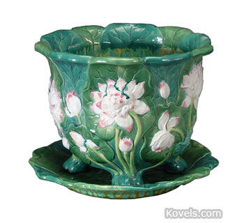 This majolica jardiniere with water lilies is marked