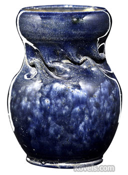 """This authentic Ohr vase, stamped """"G.E. Ohr, Biloxi, Miss,"""" sold for $3,075 at a Rago auction in Lambertville, N.J. The in-body twist and mottled indigo glaze are typical Ohr pottery features."""