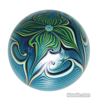 Orient & Flume started making paperweights in 1972 in Chico, Calif. This iridescent weight, made in 1978, sold at a Brunk auction in Asheville, N.C., for $208. It is 2 inches high.
