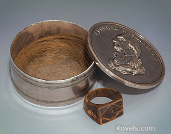 This silver box holds the hair of President George Washington. It sold, along with his wooden ring, for $58,000 at a MastroNet auction.