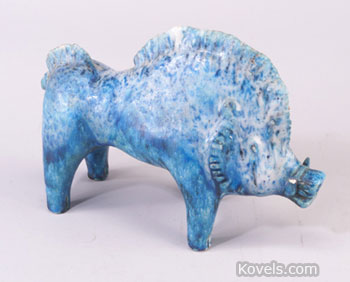 This turquoise blue pottery figure of a boar by Gambone is marked