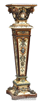 R?rstand, a Swedish firm started in 1726, made this 45-inch-tall majolica pedestal with four women's faces and other decorations. It was new in 1893 at the Columbian Exposition in Chicago. James Julia auctions got $4,025 for it this year.