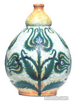 This exceptional Royal Bonn vase is decorated with a painted floral design. The 6-inch vase sold for $526 at a Treadway-Toomey Galleries auction in Oak Park, Ill.