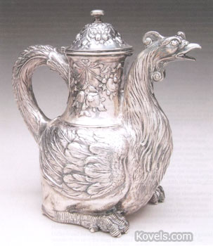 This silver chocolate pot is shaped like a rooster. It was probably made in France in the 18th century. Notice the special knob at the top of the lid. James Julia Auctions, Fairfield, Me., sold the pot last year for $4,600.