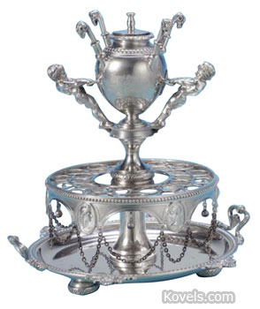 Cigars stood in the holes in the center of this sterling silver cigar accessory. The urn at the top is a lighter. The piece was made by Edward Moore for Tiffany & Co. and sold for $13,750 at a Sotheby's auction in New York.