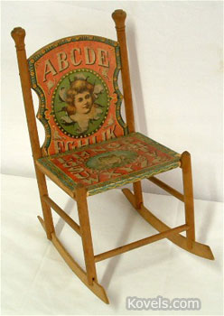 The 14-inch height of this chair indicates that it's an 1885 doll's chair. It is decorated with a color paper lithograph featuring the ABCs, frogs and animals. It sold at Mebane Antique Auction Gallery in Mebane, N.C., for $550.